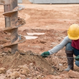 Piling through contaminated soil